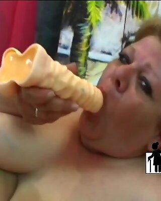 Busty granny riding fat stiff dick