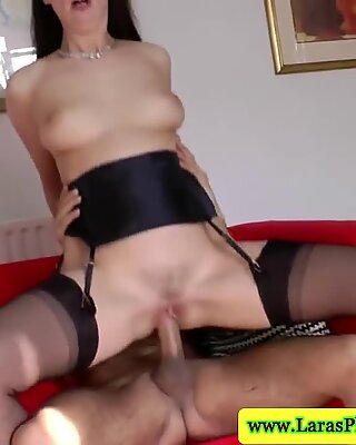 Hot mature in stockings rides young cock