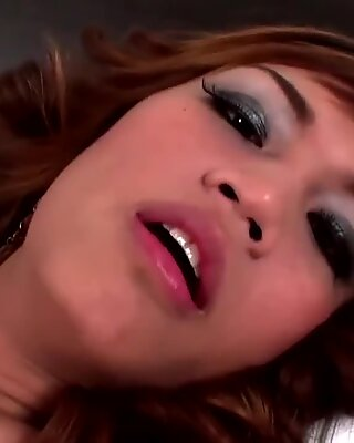 Seductive Asian femboy splashes cum all over her small tits