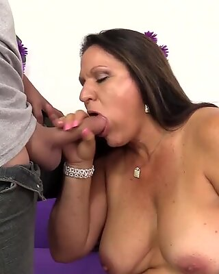 Older Brunette Takes a Prick in Her Mouth and Pussy